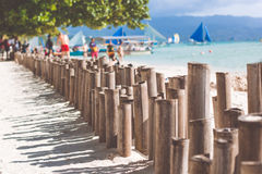 Bamboo sticks on the beach with white sand Stock Image
