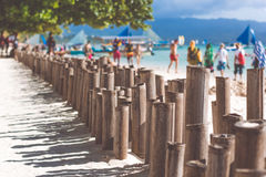 Bamboo sticks on the beach with white sand Royalty Free Stock Image