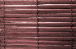 Bamboo sticks brown wooden background with thread uniting.  royalty free stock images