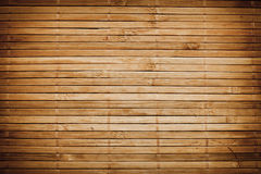Bamboo sticks wooden background Royalty Free Stock Images