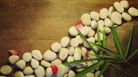 Bamboo and pebble on the wooden background stock photography