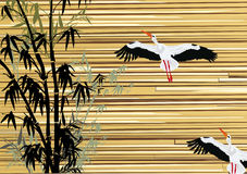 Bamboo and storks on wooden background Royalty Free Stock Photography