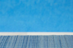 Bamboo straw mat with swimming pool blue background Royalty Free Stock Image
