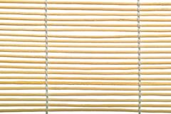 Bamboo sunblind macro. Bamboo curtain texture isolated of white background Royalty Free Stock Images