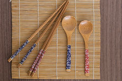 Bamboo sushi tools over a bamboo mat Stock Photos