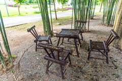 Bamboo table and chairs in garden Royalty Free Stock Photos