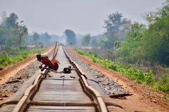 Bamboo train tracks under reconstruction stock photo