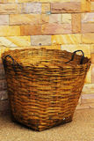 Bamboo trash basket with a stone background. Stock Photography