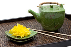 Bamboo tray, green ceramic teapot Stock Photos