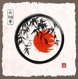 Bamboo trees and red sun in black enso zen circle Royalty Free Stock Photos