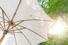 Bamboo umbrella asian style made with calico for sun shade Royalty Free Stock Image