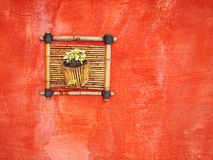 Bamboo vase. At the red wall royalty free stock photos