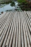 Bamboo walkway on the pond royalty free stock photos