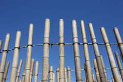 Bamboo wall decoration. Against clear blue sky Stock Photo