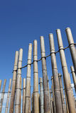 Bamboo wall decoration. Against clear blue sky Royalty Free Stock Photos