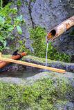 Bamboo Water Fountain. With Stone Basin Stock Images