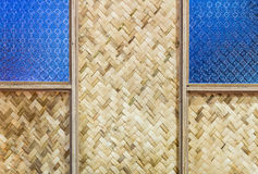 Bamboo weave with blue glass. Wall of the Thai house Royalty Free Stock Image