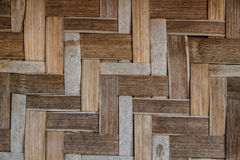 Bamboo weave. Old bamboo texture, weave cross a square corner Royalty Free Stock Photo