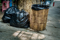 Bamboo weave trash can. With black plastic bag Stock Image
