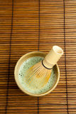 Bamboo whisk in green tea Royalty Free Stock Photos