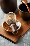 A bamboo whisk for matcha tea on a ceramic plate Royalty Free Stock Photography