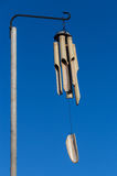 Bamboo wind chimes against a blue sky Stock Image