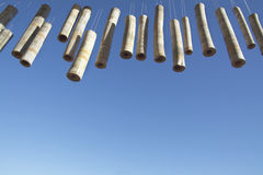 Bamboo Wind Chimes with Deep Blue Skies. Wooden Mobile Bamboo Elongated Hollow Wind Chimes White Strings with Deep Blue Skies Hanging Wirikuta Garden Los Cabos Stock Photography
