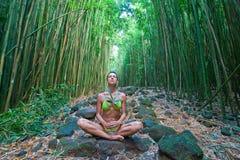 Bamboo woman meditate. Woman in green bikini in bamboo forest to meditate Royalty Free Stock Image