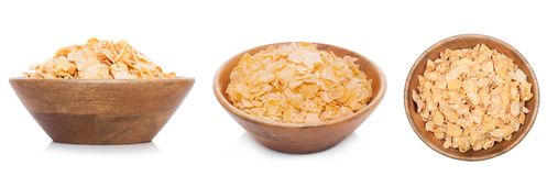 Bamboo wood bowl with organic granola cereal. Bamboo wood bowl with natural organic granola cereal corn flakes on white.Top view stock image