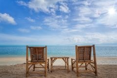Bamboo wood chair on the beach Royalty Free Stock Photography