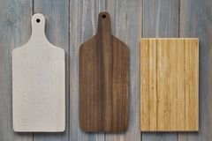 Bamboo wood cutting board on a wooden gray background.  royalty free stock images