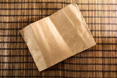 Bamboo wood mat background texture with vintage paper in center Stock Photos