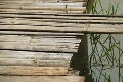 Bamboo wood path bridge cross pass over rice field. Bamboo wood path bridge cross pass over the rice field stock photos
