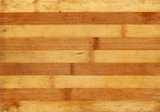 Bamboo wood scratched board realistic photo texture. Warm striped background for your design. Stock Photography