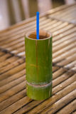 Bamboo wooden cup with traditional drink sold at night  market Stock Images