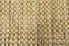 Bamboo woven beige mat handmade background. Wicker wood texture Stock Image