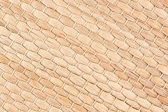 Bamboo woven beige mat handmade background. Wicker wood texture. Diagonal strips Royalty Free Stock Photography