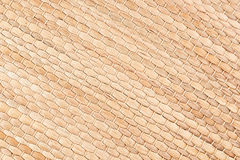 Bamboo woven beige mat handmade background. Wicker wood texture. Diagonal strips Stock Photos