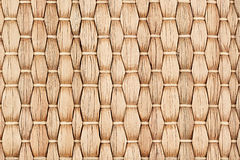 Bamboo woven beige mat handmade background. Wicker wood texture. Vertical strips Stock Image