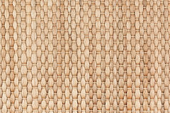 Bamboo woven beige mat handmade background. Wicker wood texture. Vertical strips Royalty Free Stock Photography