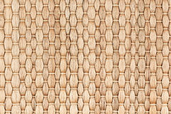 Bamboo woven beige mat handmade background. Wicker wood texture. Vertical strips Stock Photography