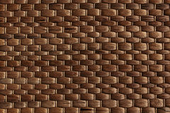 Bamboo woven brown mat handmade background. Royalty Free Stock Image