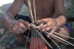 Bamboo woven by hand. A man demonstrations use of bamboo woven by hand Stock Photography