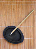 Bamboo writing brush for calligraphy. An image showing the traditional writing instruments for an ancient type chinese calligraphy or drawing. A calligraphic or Stock Image