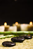Bamboo and zen stones. With candles royalty free stock photo