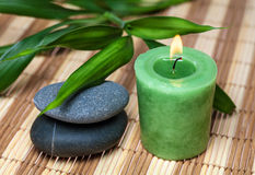 Bamboo, zen stones and candle. In spa still life stock image