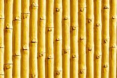 Bambu gjort gulaktigt bakgrundsfotografi arkivfoton