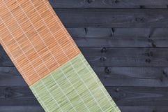 Bambu som är matt på trätabellen, bästa sikt arkivfoto