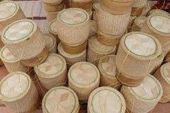 Bambuhemslöjd för klibbiga ris på den årliga Lumpini kulturella festivalen Fotografering för Bildbyråer