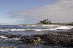 Bamburg Castle IV. Bamburgh Castle is probably the finest castle in England. It is perched on a basalt outcrop on the very edge of the North Sea at Bamburgh Royalty Free Stock Photography